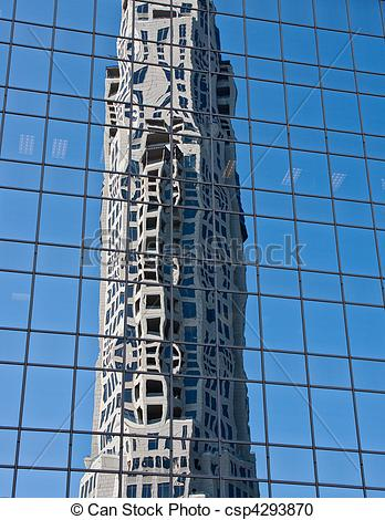 Stock Photography of Concrete Office Tower Reflected in Blue Glass.