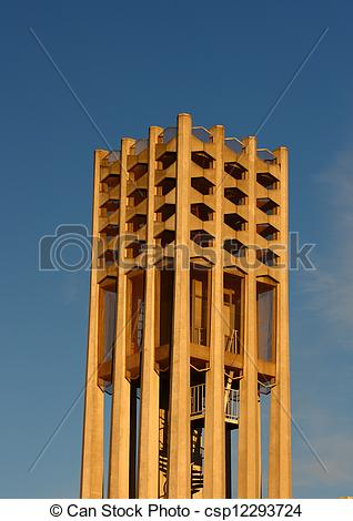 Clip Art of Cement Bell Tower Under Blue Sky.