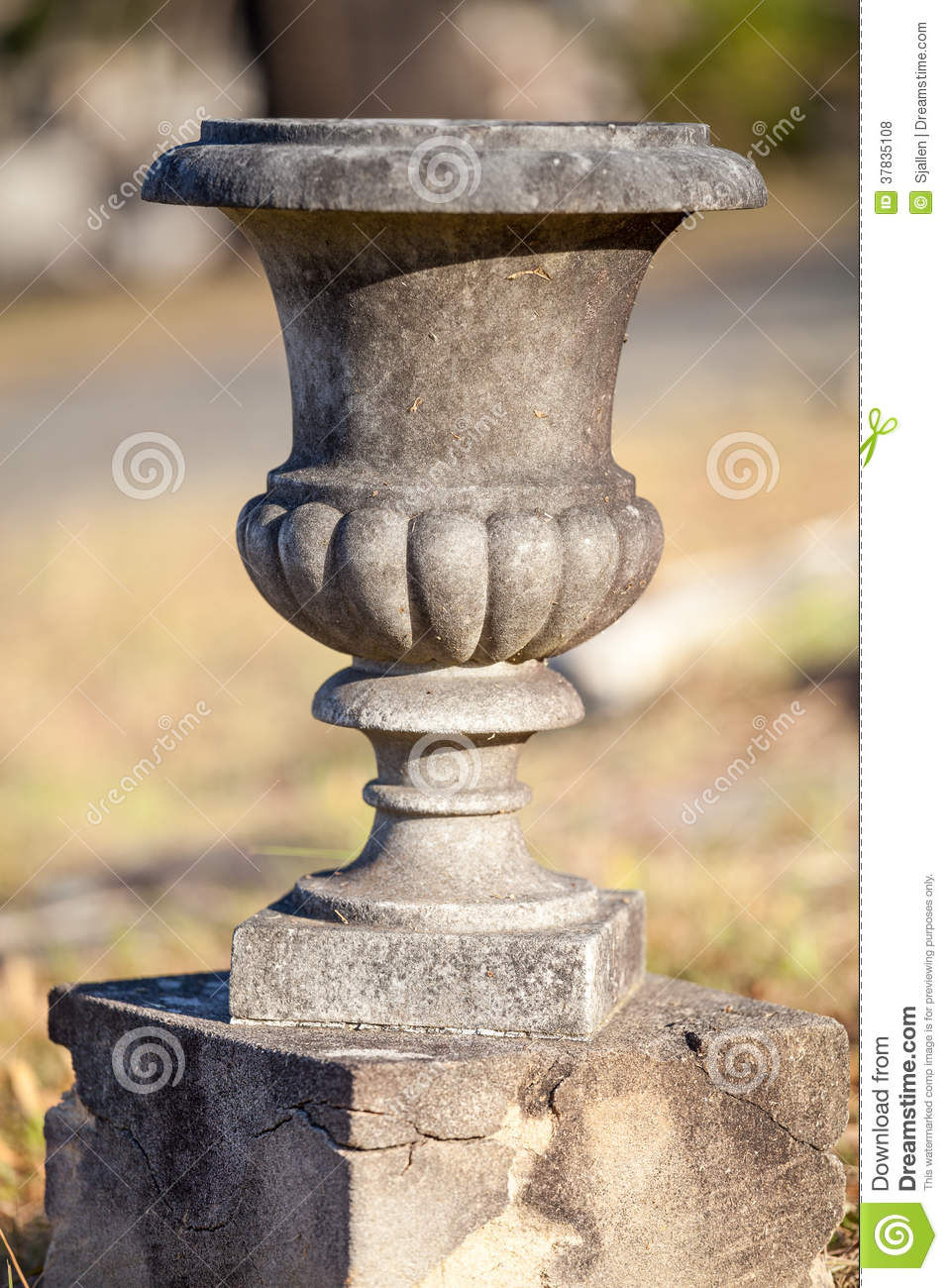 Empty Old Concrete Or Stone Urn On A Small Plinth Royalty Free.