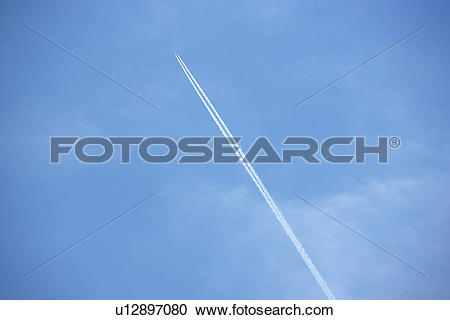 Stock Photography of White Condensation Trail From A Jet As It.