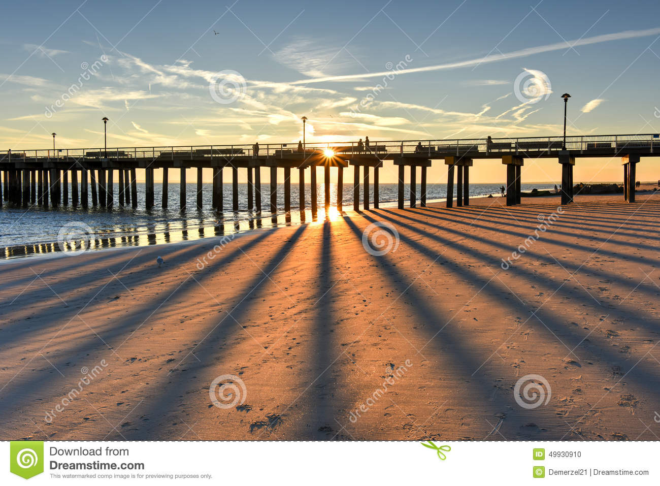 Coney Island Beach At Sunset Stock Photo.