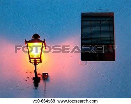 Pictures of Street lamp in a street at night. Conil de la Frontera.