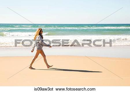 Stock Images of Bare legged woman wearing hoody striding out on.