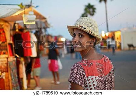 Stock Photography of Young woman in street hippy market, Conil de.
