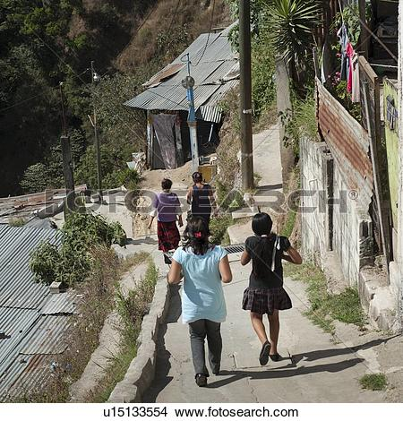 Stock Photo of Women walking on stepped walkway, Colonia Bethania.