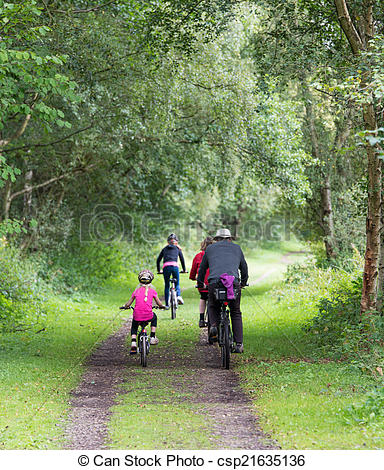 Stock Photos of family group cycling.