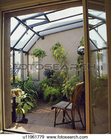 Stock Photograph of Open door to small modern conservatory with.