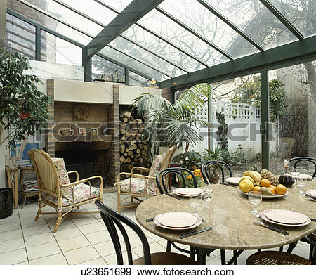 Stock Photograph of Bentwood and wicker furniture in conservatory.