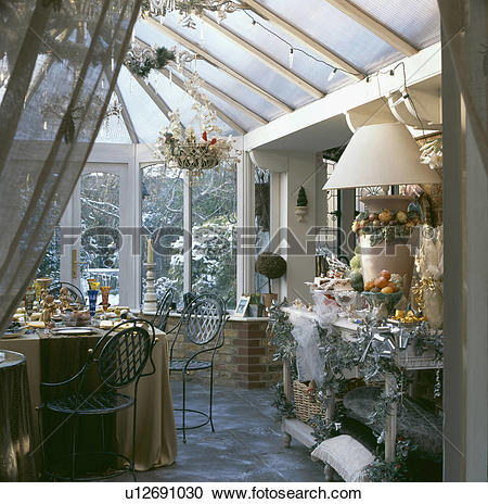 Stock Photography of View into conservatory dining room with.