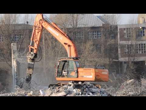 Excavator Doosan and powerful pulverizer and concrete scissors.