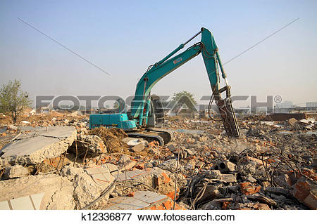 Picture of excavator in the construction debris clean up site.