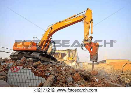 Stock Photo of excavator in the construction debris clean up site.