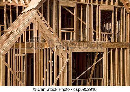 Pictures of Part of a house in the framing phase of construction.
