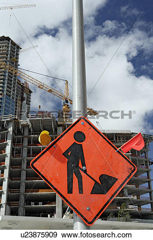 Stock Photograph of Construction site with red construction sign.