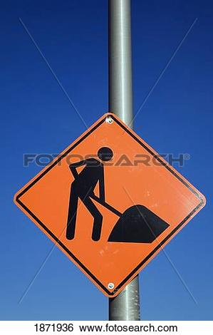 Stock Images of orange pictogram 'men at work' construction sign.
