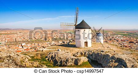 Stock Photo of Famous windmills of Consuegra at sunset, province.