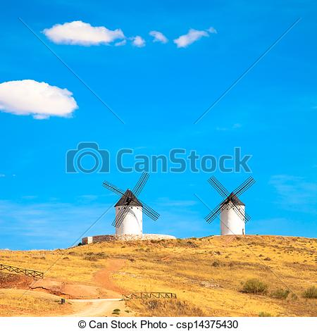 Stock Photos of Windmills, rural green fields and blue sky.