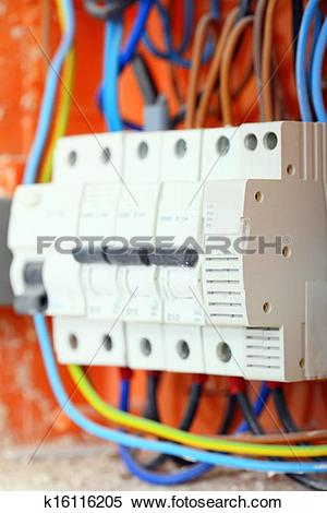 Stock Image of Electrical panel box with fuses and contactors.