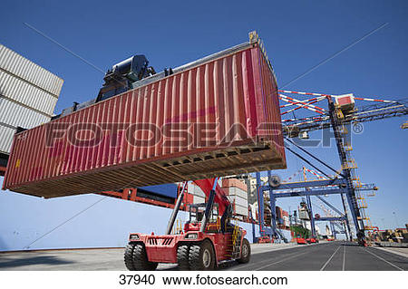 Stock Photography of Mobile crane moving cargo container at.