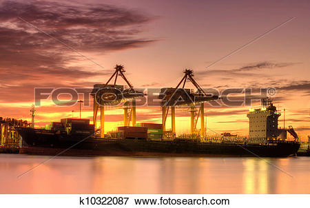 Picture of Container Cargo freight ship with working crane bridge.