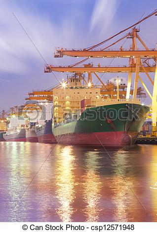 Stock Photo of Container Cargo freight ship with working crane.