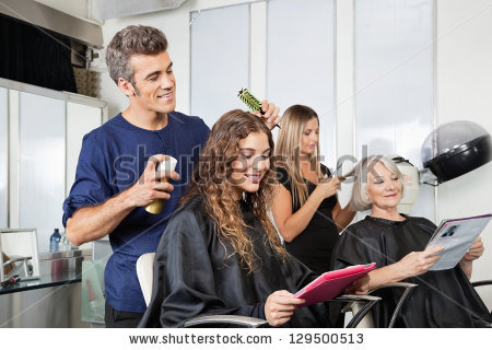 Male Female Hairdressers Setting Clients Hair Stock Photo.