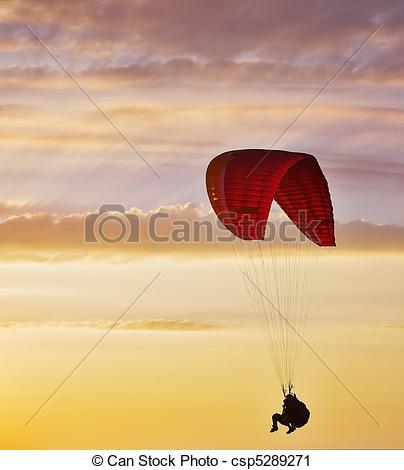 Stock Photography of Flight on an operated parachute in twilight.