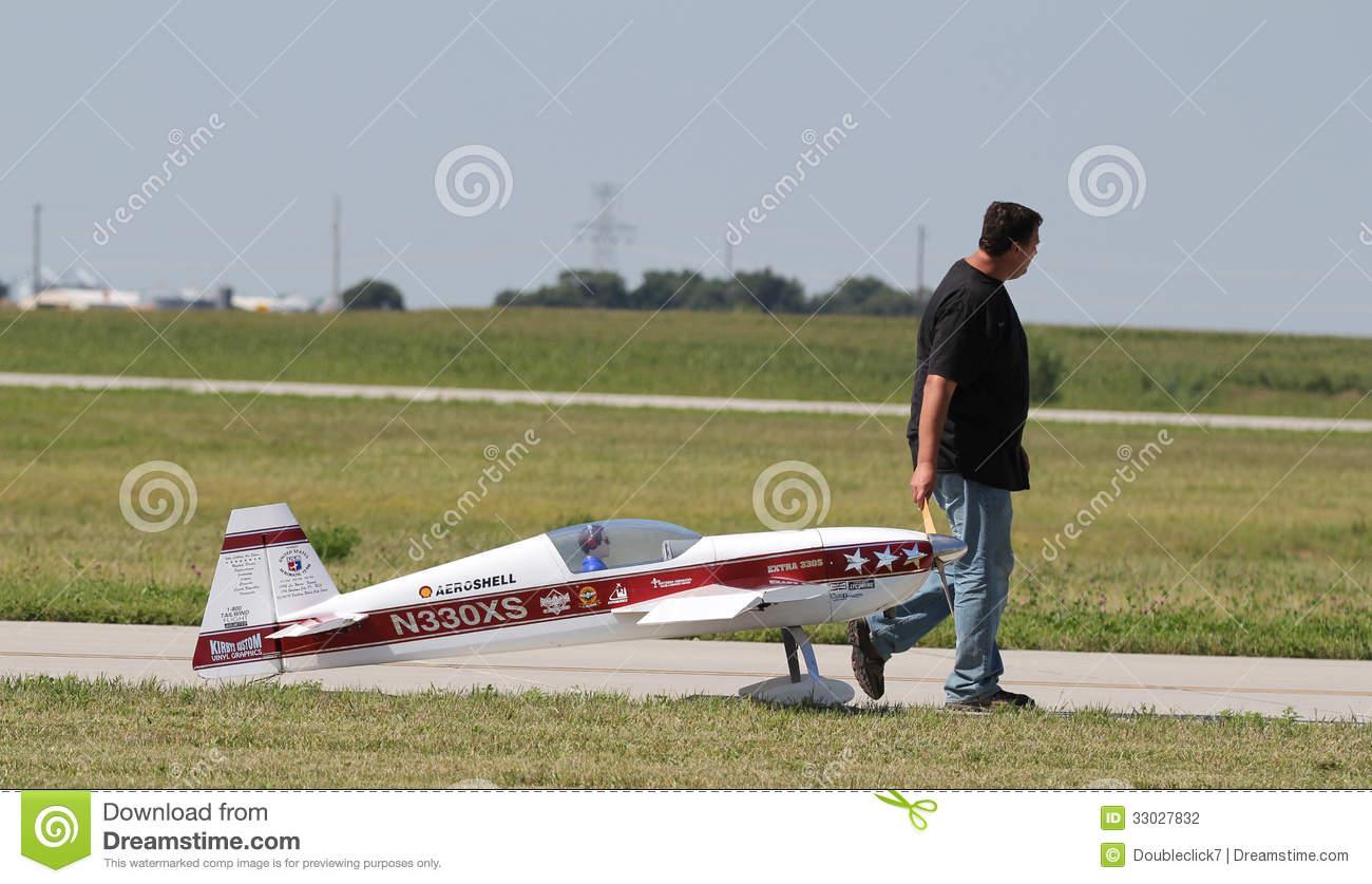 Man Pulls Red Model Airplane Editorial Photography.