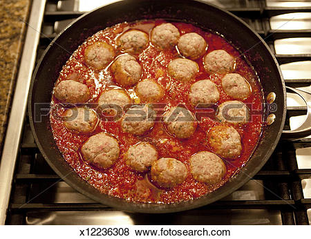 Pictures of Homemade meatballs and sauce cooking on the stove.