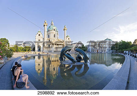 Stock Photo of Tourists sitting at poolside, Karlskirche.