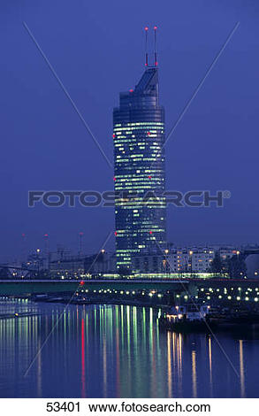 Stock Photography of Reflection of tower in river at night.