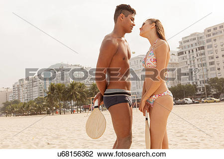 Stock Photo of Young couple about to kiss on Copacabana Beach, Rio.