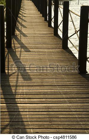 Stock Illustration of Wooden bridge walkway through the coppice.