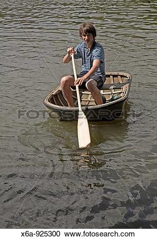 Stock Photography of Boy paddling coracle x6a.