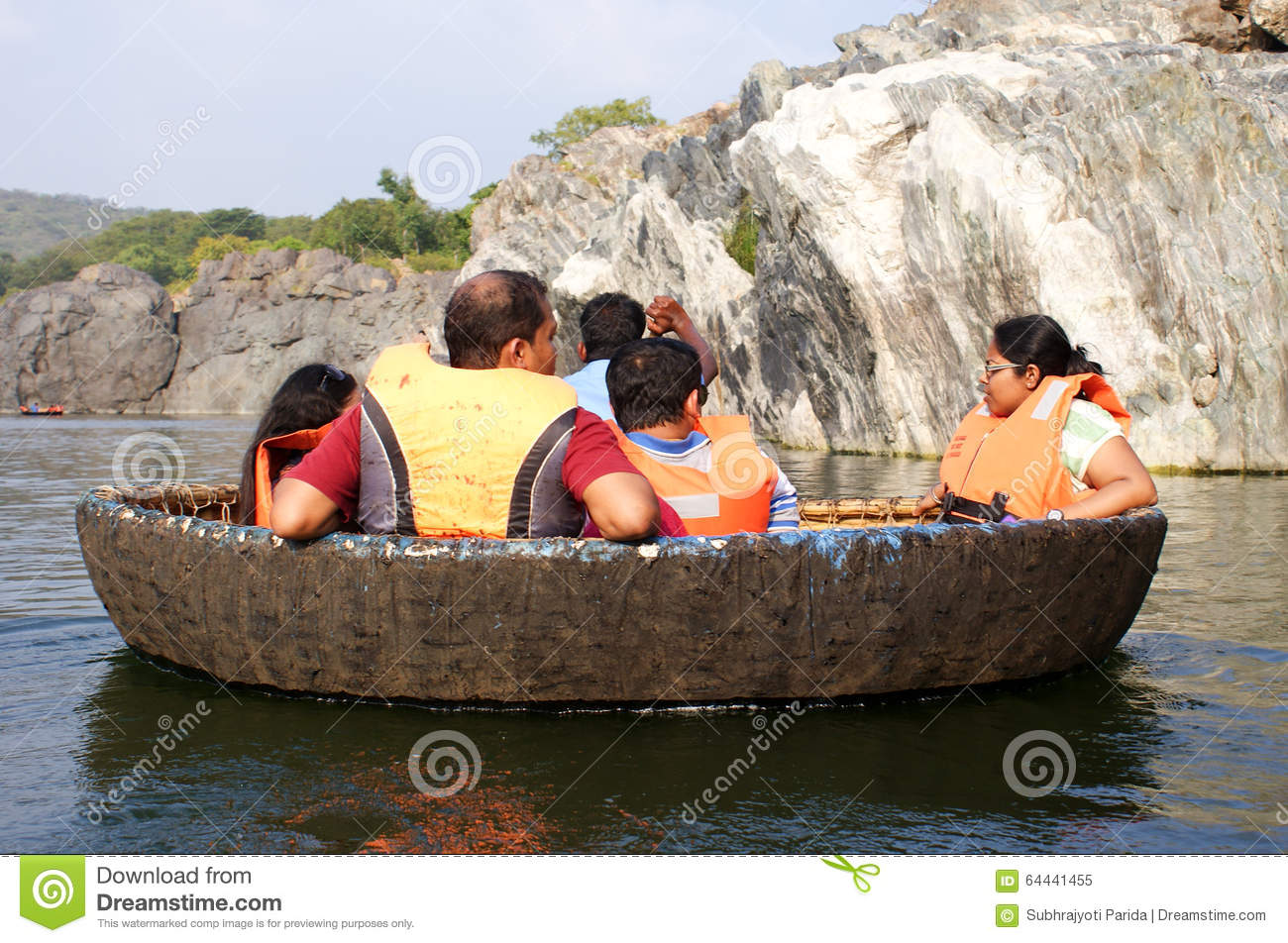 A Tourist Family On A Coracle Ride At Hogenakkal Falls, Tamil Nadu.