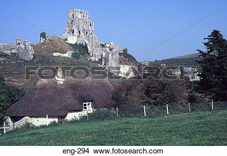 Stock Photo of Corfe Castle with Thatched Cottage Below Dorset eng.