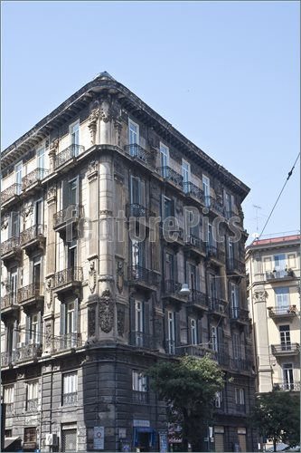 An old corner apartment or hotel building in Naples Italy, italian.