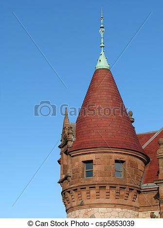 Stock Photographs of victorian corner tower with pointed red roof.