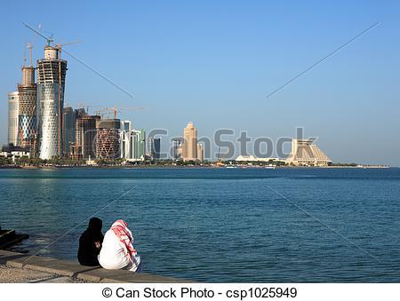 Stock Photographs of Qatari couple on Doha Corniche.