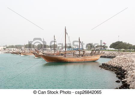 Stock Image of Boats (Dhow) mooring at Doha Corniche, Qatar.
