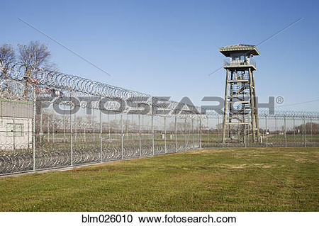 Stock Photography of Prison fence, locked gate and barbed wire at.