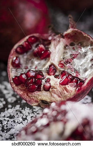Stock Photography of Opened pomegranate with corsican sea.