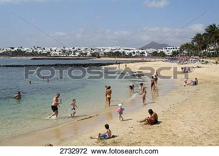 Stock Photo of Tourists on beach, Costa Teguise, Playa des.