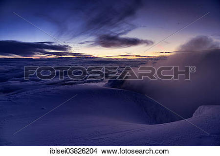 "Stock Photo of ""Sunrise at the summit of Cotopaxi Volcano, Quito."