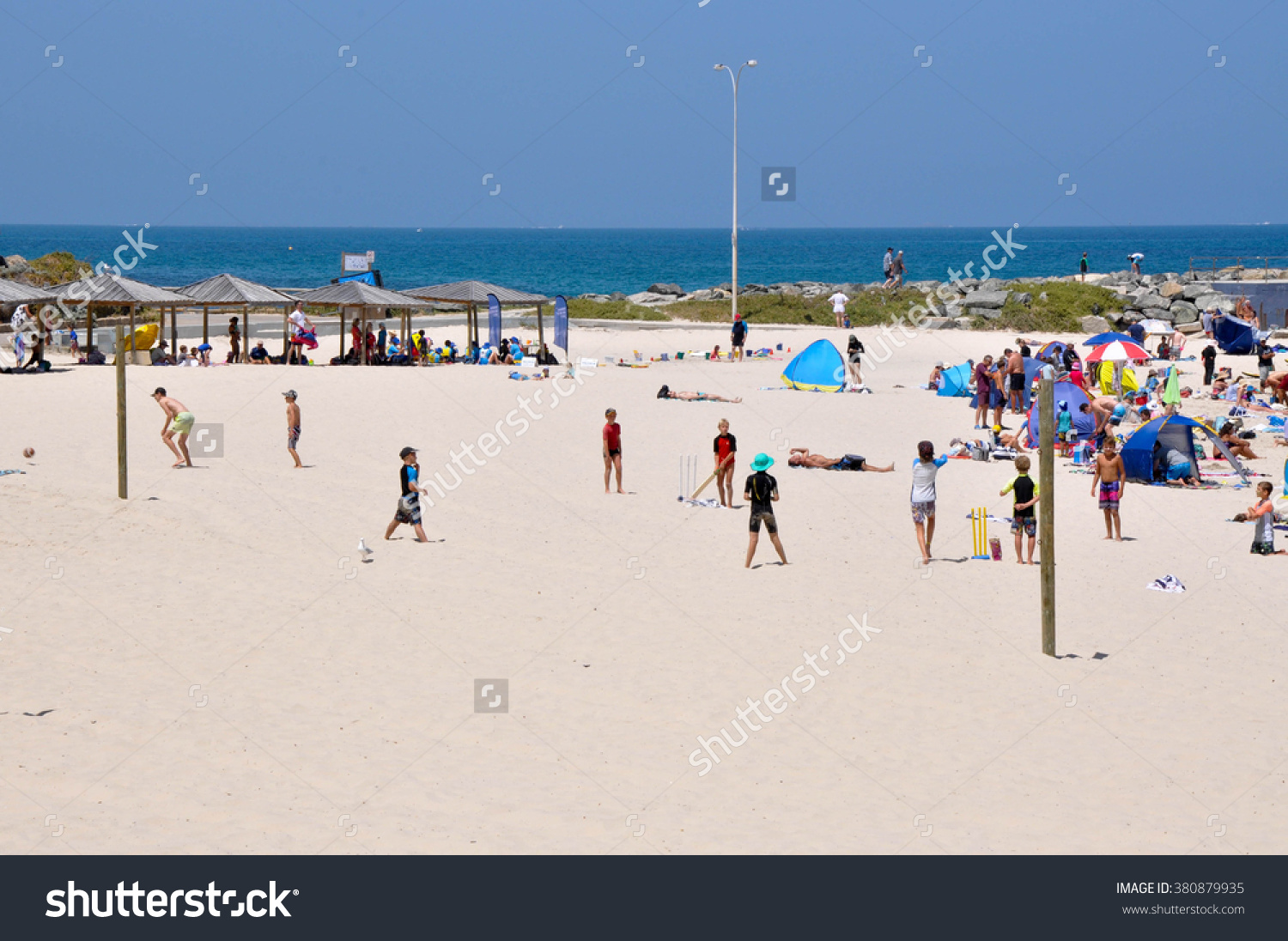 Kids Playing Cricket At Cottesloe Beach In Western Australia/Beach.