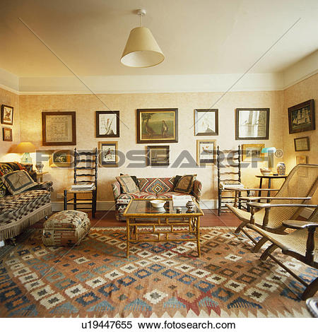 Stock Image of Kelim carpet and antique furniture in country.
