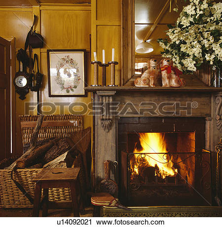 Stock Photography of Fireplace in traditional country living room.