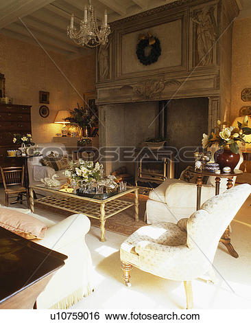 Stock Images of Cream armchair and sofas in French country living.