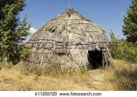 Stock Photography of Traditional straw hut in greek country.