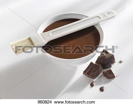 Stock Photo of Milk couverture with brush, pieces of chocolate.